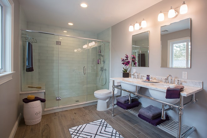 Interior design master bath in private residence on Long Island NYC. Double sink big shower purple details. By California Architectural photographer Ella Bessette.