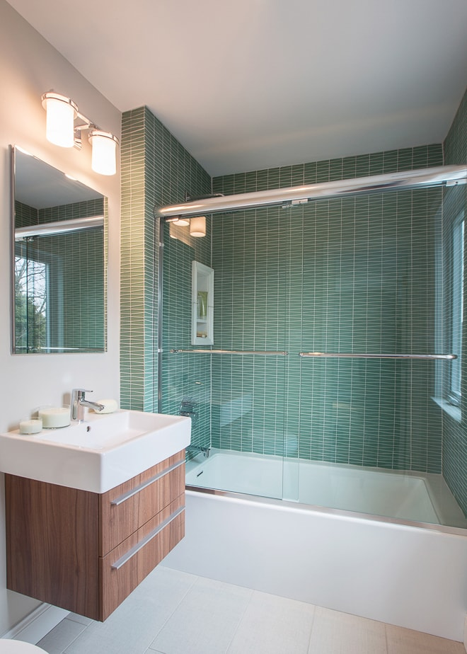 Interior design bathroom renovation in Long Island private residence. Green tile detail. Shot by California architectural photographer Ella Bessette