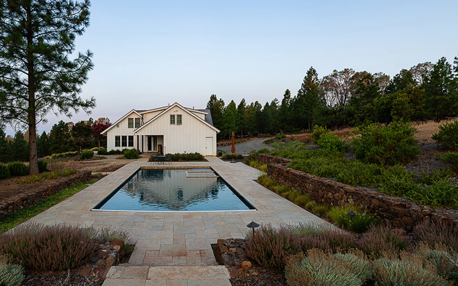Napa California private residence landscape design with pool and stone decking at dawn. Photo by Architectural photographer Ella Bessette
