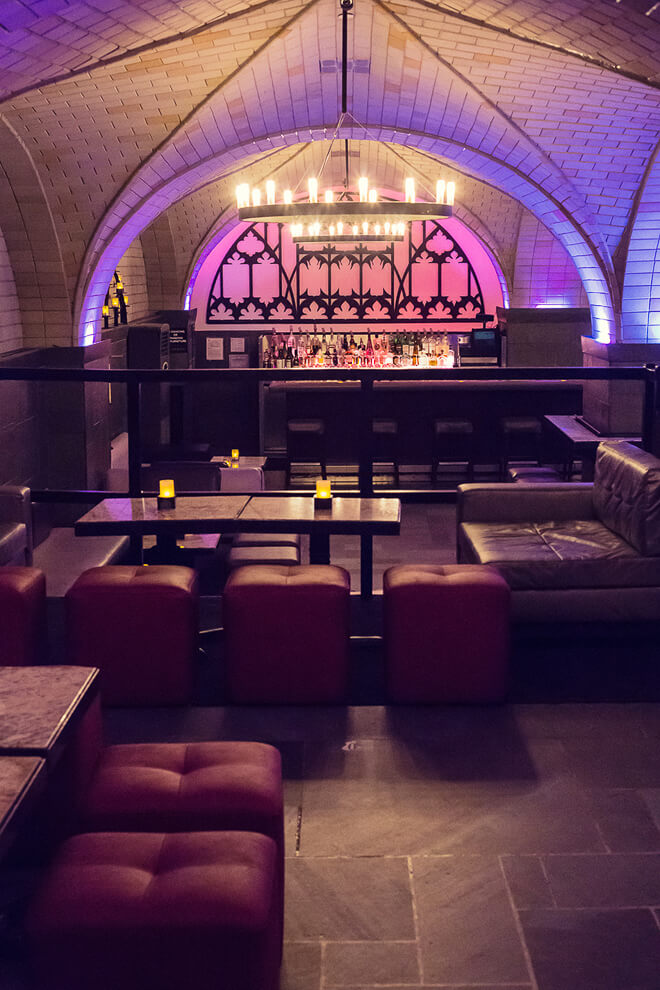 Architectural Interior Photography, nightclub at Bryant Park Hotel NYC with purple lighting brick and leather. Photographer Ella Bessette