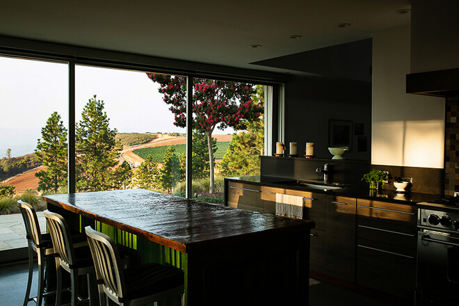 Modern rustic kitchen breakfast bar overlooking Napa Vinyards. Photographed by Ella Bessette, Architectural Photographer