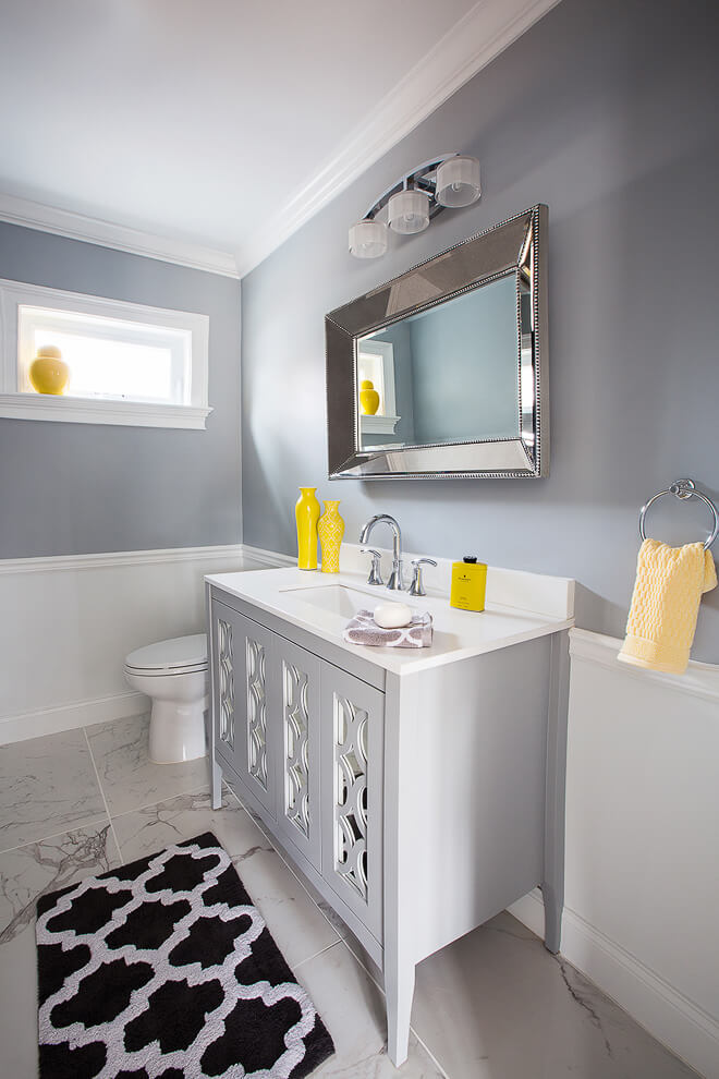 Small gray & white half bath with yellow accents. Long Island NY private residence by architectural photographers Ella Bessette.