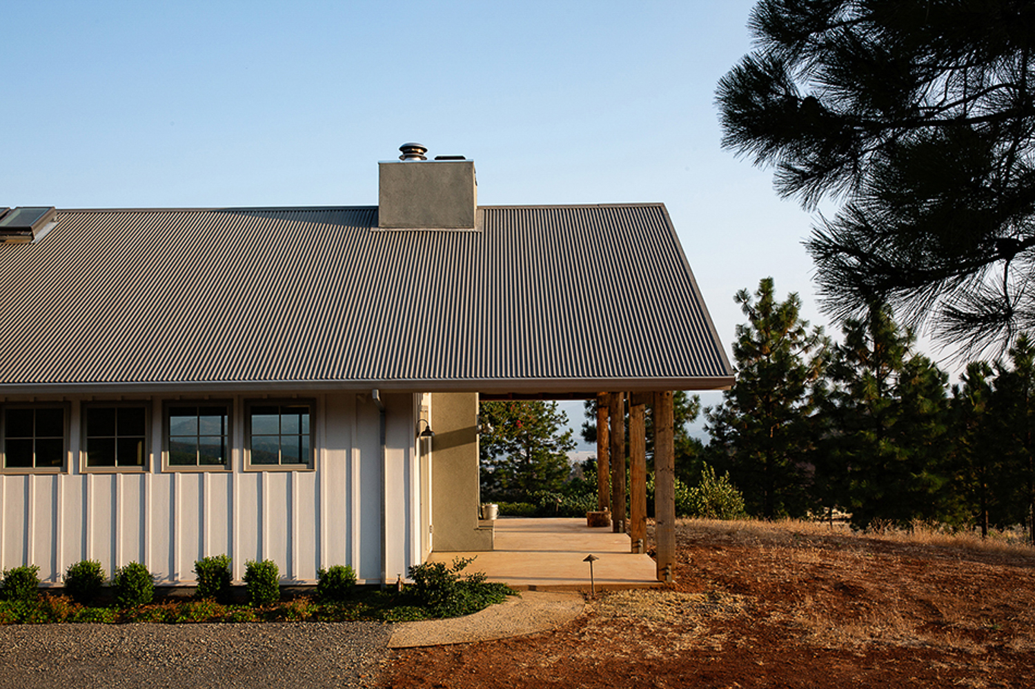 Napa residential design photographer, barn style house with exterior fireplace. Wine country architecture.
