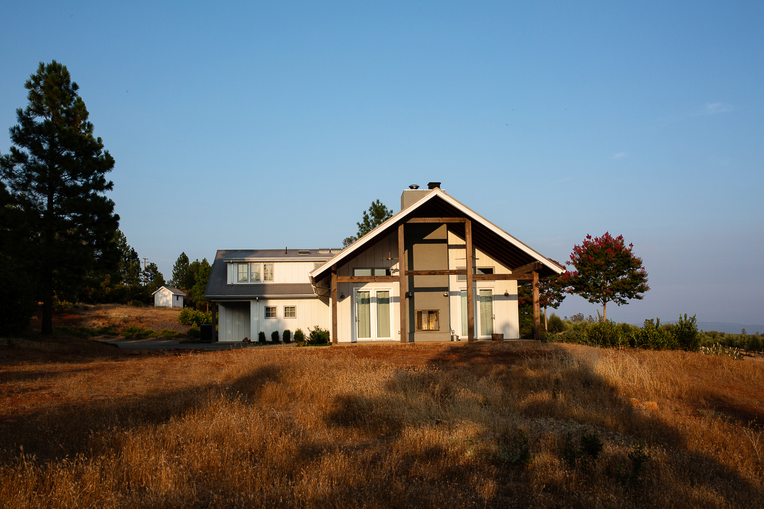 Wine Country architectural photographers Ella Bessette. Barn style residence with natural landscaping