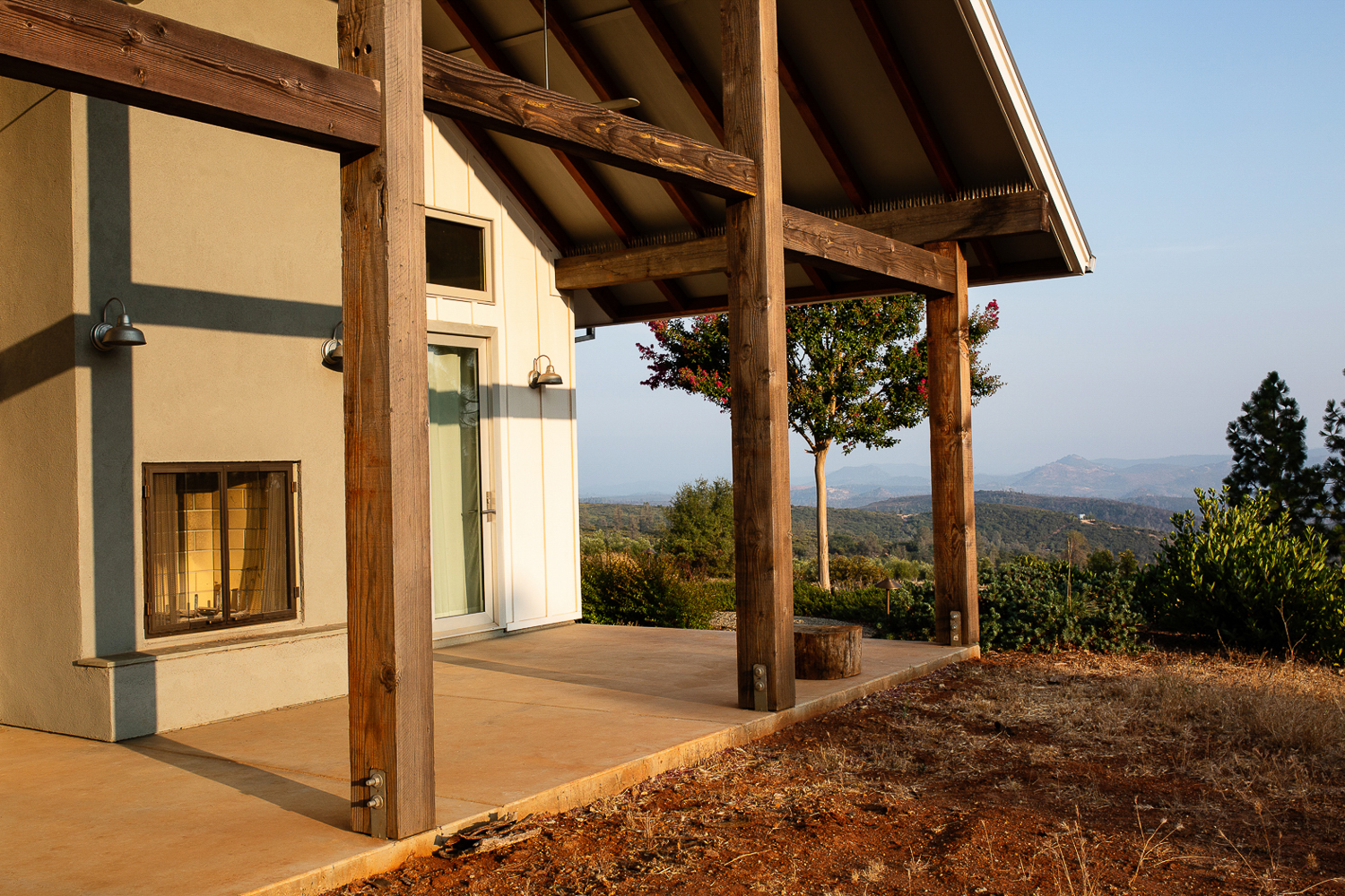 Patio with outdoor fireplace in Napa Valley home by high end Residential photographer Ella Bessette