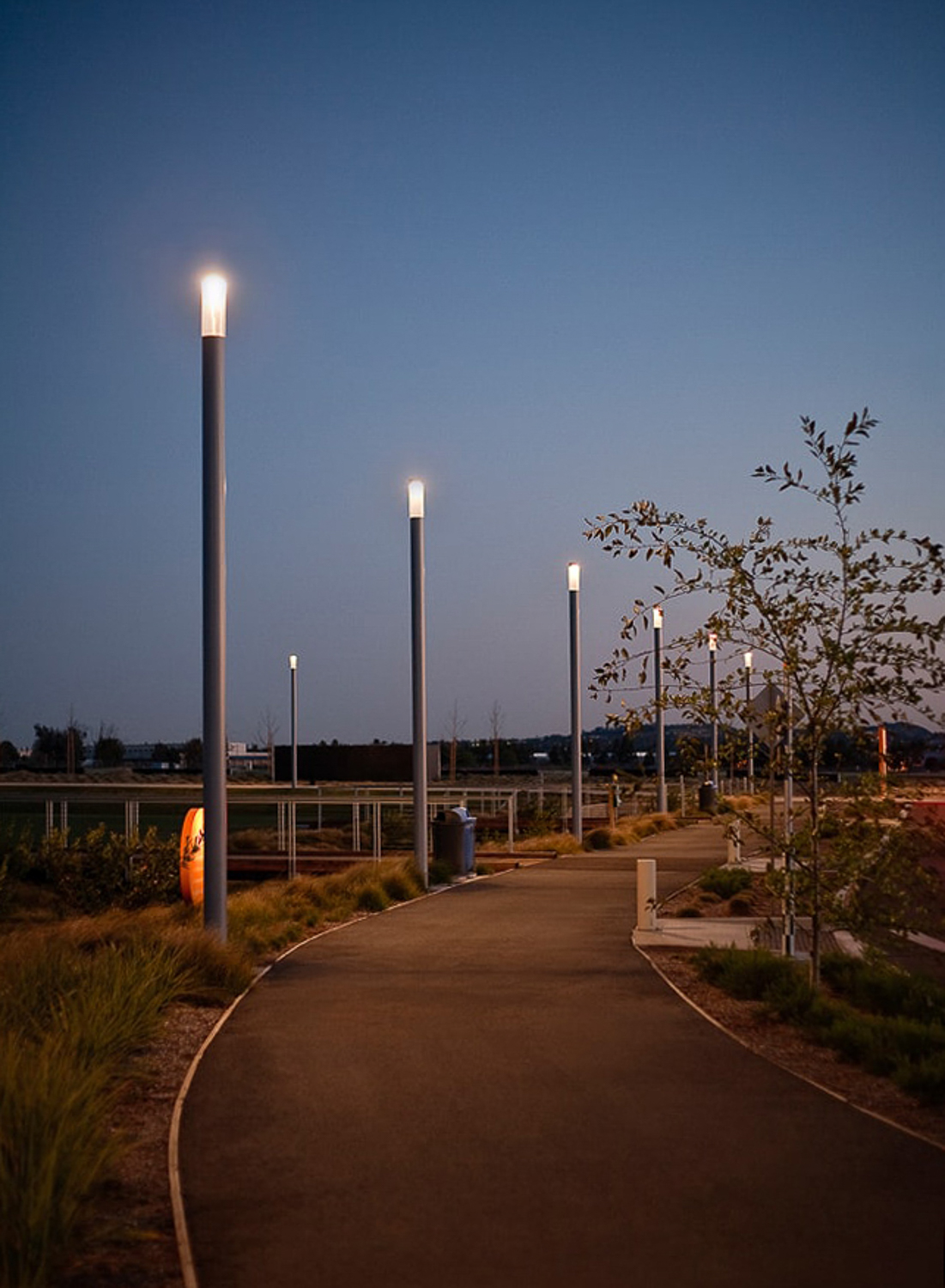 Orange County Park at dusk by lighting design photographer. Walkway with dark sky lighting.